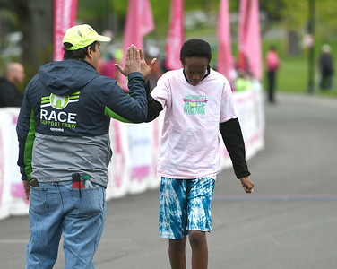 5/12/2018 Mike Orazzi | Staff Zachary Hussein takes first place in the kids fun run during the CT Race in The Park Saturday morning in New Britain's Walnut HIll Park.