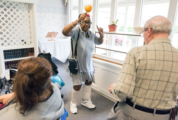 05/15/18 Wesley Bunnell | Staff Singer Kate Stone entertained the residents of Autumn Lake Healthcare in New Britain during Happy Hour on Wednesday May 15th. Shantel Brown dances with her maraca along with Sebby Lanza who is the husband of a resident.