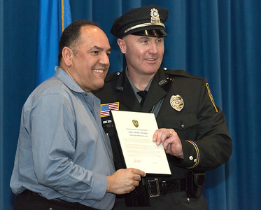 05/15/18  Wesley Bunnell | Staff  Berlin Police held their 2018 Awards Ceremony on Tuesday May 15th at Eversource Energy at 107 Selden St.  Officer Thomas Blake poses for a photo with Louis Rivera after receiving his Lifesaving Award for his role in helping to save Rivera's life.