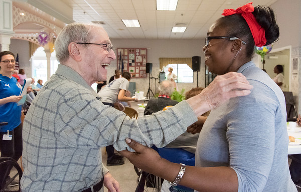 05/15/18 Wesley Bunnell | Staff Singer Kate Stone entertained the residents of Autumn Lake Healthcare in New Britain during Happy Hour on Wednesday May 15th. Sebby Lanza, L, whose wife is a resident of the facility gets ready to hug resident Shauntel Brown after dancing together during a song.