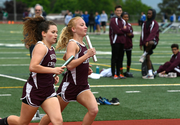 5/16/2018 Mike Orazzi | Staff Bristol Central's Alex Sirko and Meghan Curtis in the 4x800 relay Wednesday at BC.
