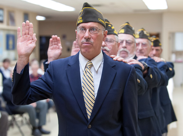05/16/18 Wesley Bunnell | Staff The Berlin VFW 10732 held their installation of officers on Wednesday May 16th. Senior Vice Commander Bill Hamel stands in for the incoming Commander who was unable to attend as Chaplain Ron Levandowsky stands behind him with his hand on his shoulder.