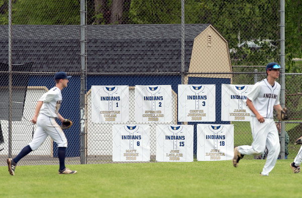 05/16/18 Wesley Bunnell | Staff Newington baseball defeated E.C. Goodwin Tech on Wednesday afternoon at Newington High School. Newington players take the field and run in front of banners honoring their graduating seniors.