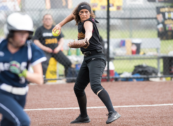 05/17/18 Wesley Bunnell   Staff New Britain softball defeated Wethersfield on Thursday afternoon at Chesley Park. Joseleen Rivera (6) throws a runner out at first.