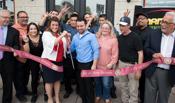 05/17/18 Wesley Bunnell   Staff Vincent Placeres held a ribbon cutting for his newest restaurant The Kitchen on Thursday afternoon down the street from Mofongo Restaurant which he opened in 2017. Economic Development Director Bill Carrol, far L, Mayor Erin Stewart, Vincent Placeres, Placeres' mother Penny Snead, business partner Mark Lally and Alderman Daniel Salerno, far R.