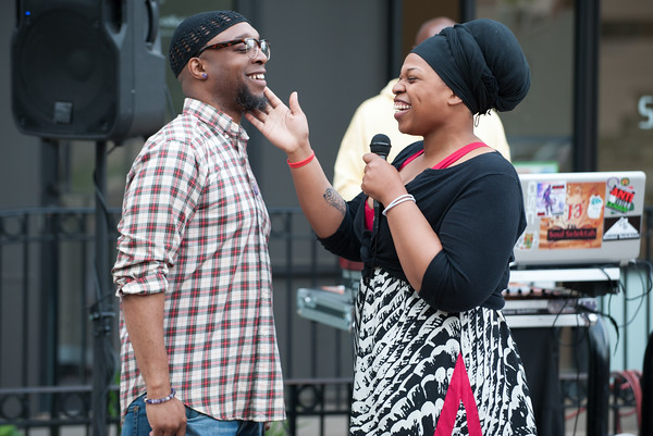 05/17/18 Wesley Bunnell   Staff The New Britain Artists' Co-op held open mic outdoors on Thursday night at KC's on Main. Oktober Brown, L, performs his remised India Ire song The Truth along with Jenee.
