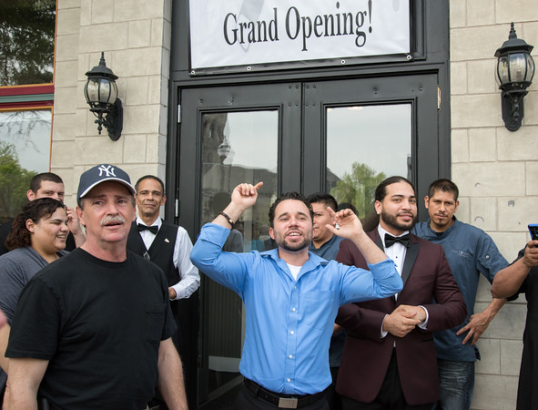 05/17/18 Wesley Bunnell   Staff Vincent Placeres held a ribbon cutting for his newest restaurant The Kitchen on Thursday afternoon down the street from Mofongo Restaurant which he opened in 2017. Business partner Mark Lally, L, Vincent Placeres and business partner Alex Dejesus.