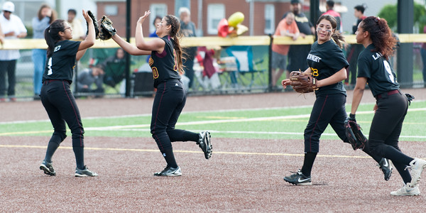 05/17/18 Wesley Bunnell   Staff New Britain softball defeated Wethersfield on Thursday afternoon at Chesley Park. Chastity Sanchez (1) greets Paola Martinez (10) after Martinez made a difficult catch in the outfield to end the inning as teammates Gianna Gonzales (4) and Jada Lawson (9) follow.