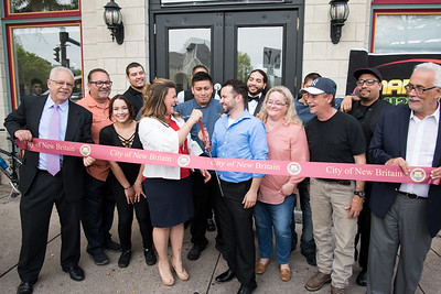 05/17/18  Wesley Bunnell | Staff  Vincent Placeres held a ribbon cutting for his newest restaurant The Kitchen on Thursday afternoon down the street from Mofongo Restaurant which he opened in 2017. Economic Development Director Bill Carrol, far L, Mayor Erin Stewart, Vincent Placeres, Placeres' mother Penny Snead, business partner Mark Lally.