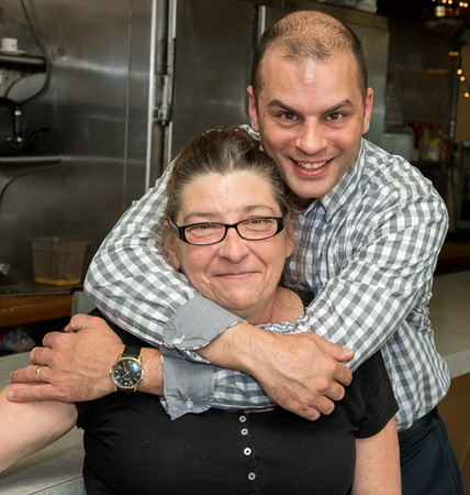 05/17/18 Wesley Bunnell   Staff New owner of Miss Washington Diner Judy Robinson is hugged by previous owner Dan Czako on Thursday afternoon inside of the restaurant. Robinson previously waitressed for 37 years before purchasing it from Czako who owned the diner since 2011.
