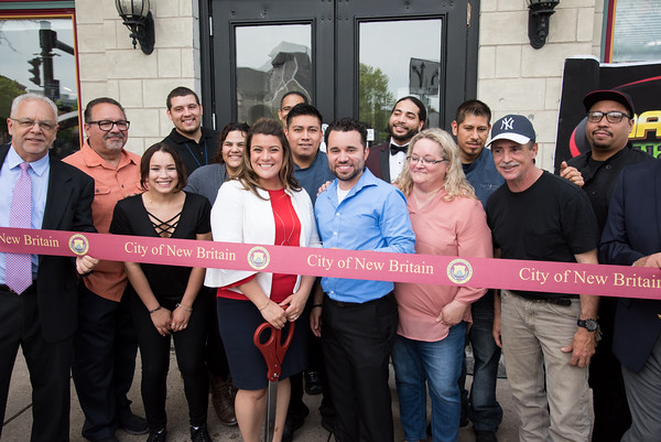 05/17/18 Wesley Bunnell   Staff Vincent Placeres held a ribbon cutting for his newest restaurant The Kitchen on Thursday afternoon down the street from Mofongo Restaurant which he opened in 2017. Economic Development Director Bill Carrol, far L, Mayor Erin Stewart, Vincent Placeres, Placeres' mother Penny Snead, business partner Mark Lally.