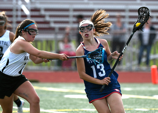 5/18/2018 Mike Orazzi | Staff Bristol Co-Op's Maddie Bourassa (7) and St. Paul's Olivia Stump (13) during lacrosse at BC Friday.
