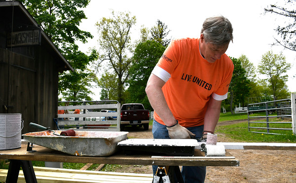 5/18/2018 Mike Orazzi | Staff United Way of Day Caring volunteer Bill Calder paints boards at Shepard Meadows Therapeutic Riding Center in Bristol Friday.
