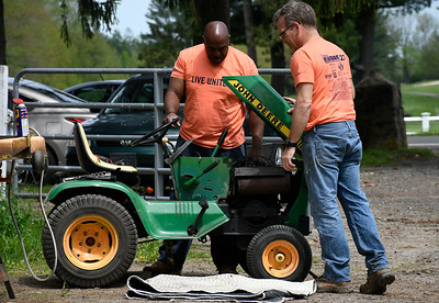 5/18/2018  Mike Orazzi | Staff United Way of Day Caring volunteers Dammein Hurdle and Geoff Butland work on getting a tractor working at Shepard Meadows Therapeutic Riding Center in Bristol Friday.