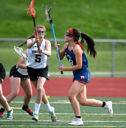 5/18/2018 Mike Orazzi | Staff Bristol Co-Op's Allison Jessie (5) and St. Paul's Maddie Fisher (3) during lacrosse at BC Friday.