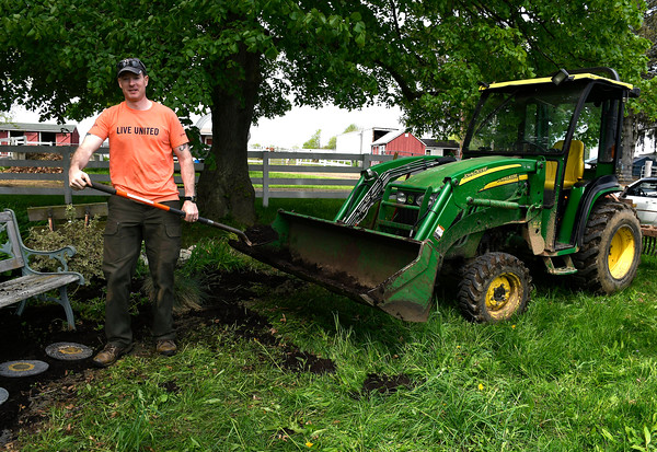 5/18/2018 Mike Orazzi | Staff United Way of Day Caring volunteer Jason Harmon while working at Shepard Meadows Therapeutic Riding Center in Bristol Friday.