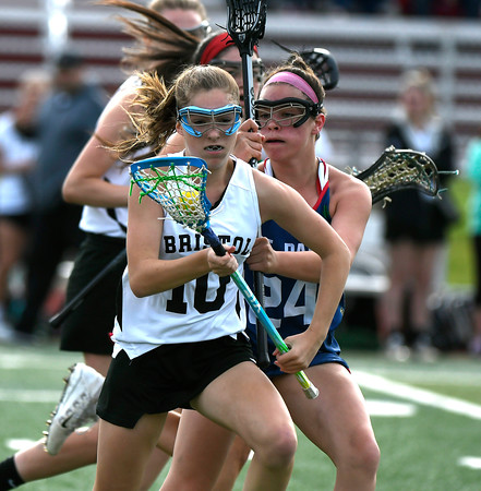 5/18/2018 Mike Orazzi | Staff Bristol Co-Op's Lily Hansen (10) and St. Paul's Cameron Baston (24) during lacrosse at BC Friday.