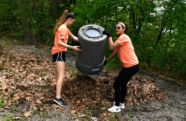 5/18/2018 Mike Orazzi | Staff United Way of Day Caring volunteers Bella Christiana and Kristine Gutierrez, while working in Lake Winfield in Plymouth Friday.