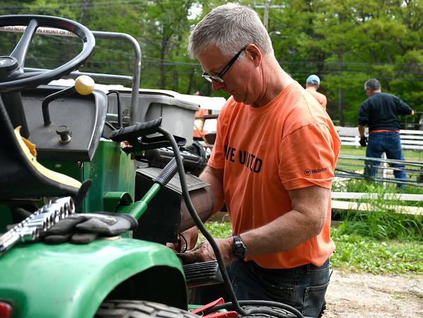 5/18/2018 Mike Orazzi | Staff United Way of Day Caring volunteer Art Casey while working on getting a tractor working at Shepard Meadows Therapeutic Riding Center in Bristol Friday.