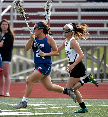 5/18/2018 Mike Orazzi | Staff Bristol Co-Op's Gabriele Abramczyk (8) and St. Paul's Catharine Ciampi (2) during lacrosse at BC Friday.