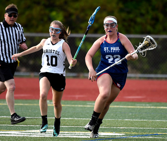 5/18/2018 Mike Orazzi | Staff Bristol Co-Op's Lily Hansen (10) and St. Paul's Meg Fortier (22) during lacrosse at BC Friday.