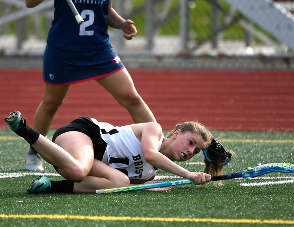 5/18/2018 Mike Orazzi | Staff Bristol Co-Op's Lily Hansen (10) during and St. Paul's Catharine Ciampi (2) during lacrosse at BC Friday.