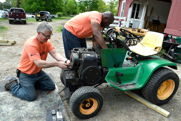 5/18/2018 Mike Orazzi | Staff United Way of Day Caring volunteers Art Casey and Dammein Hurdle work on getting a tractor working at Shepard Meadows Therapeutic Riding Center in Bristol Friday.