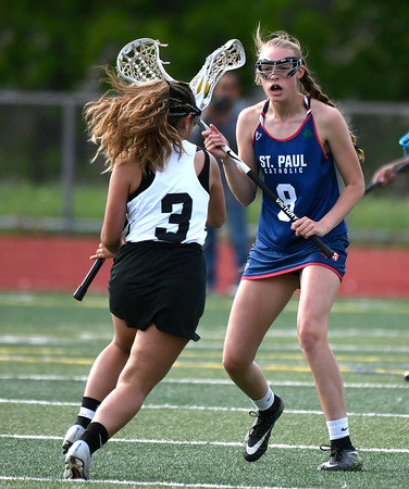 5/18/2018 Mike Orazzi | Staff Bristol Co-Op's Aly Policarpio (3) and St. Paul's Addison Davis (8) during lacrosse at BC Friday.