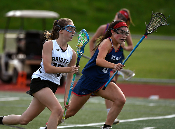 5/18/2018 Mike Orazzi | Staff Bristol Co-Op's Lily Hansen (10) and St. Paul's Maddie Fisher (3) during lacrosse at BC Friday.