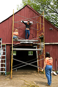 5/18/2018  Mike Orazzi | Staff United Way of Day Caring volunteers work on a barn at Shepard Meadows Therapeutic Riding Center in Bristol Friday.
