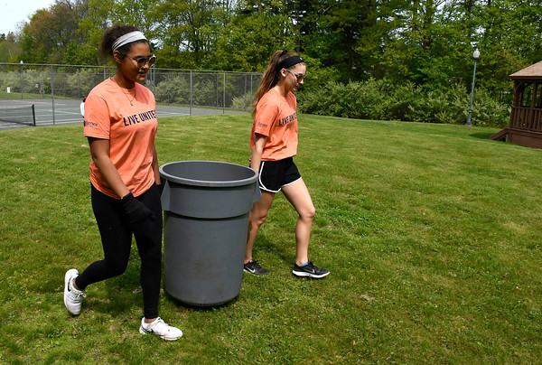 5/18/2018 Mike Orazzi | Staff United Way of Day Caring volunteers Kristine Gutierrez and Bella Christiana while working in Lake Winfield in Plymouth Friday.