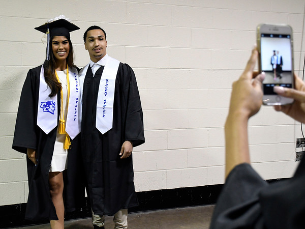 5/19/2018 Mike Orazzi | Staff CCSU student athletes Aleena Garcia and Deshawn Parker while at the XL Center for the CCSU commencement ceremony Saturday in Hartford.