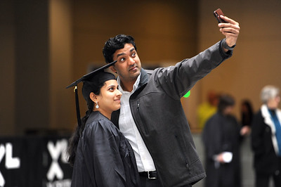 5/19/2018 Mike Orazzi | Staff Meera Mukundan and her husband Vinesh while at the XL Center for the CCSU commencement ceremony Saturday in Hartford.