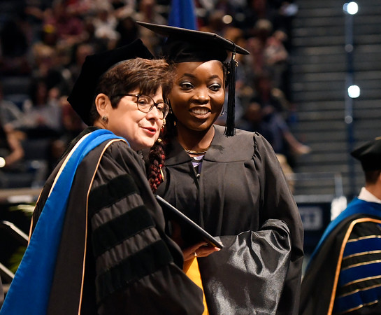5/19/2018 Mike Orazzi | Staff CCSU President Zulma R. Toro and Oluwadamilola Olabisi Opayemi during the commencement ceremony Saturday in Hartford.