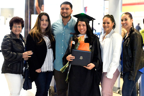 5/19/2018 Mike Orazzi | Staff M.J. Martinez poses with family after the morning CCSU commencement ceremony Saturday in Hartford at the XL Center.