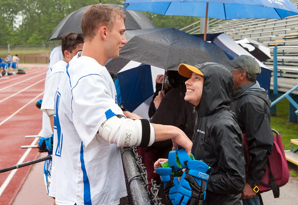 05/22/18 Wesley Bunnell | Staff Southington lacrosse had their season ended with a loss to Glastonbury on Tuesday afternoon at Southington High School. Derek Guida (14) talks with girlfriend Jasmin Cahill at the fence after the game.