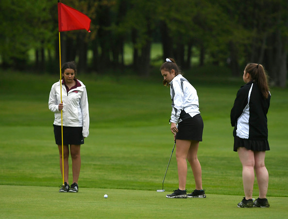 5/22/2018 Mike Orazzi | Staff St. Paul's Natalie Millerick (center) along with Naugatuck's Sofia Marques (left) and Abbi Pruchnicki (right) during Tuesday's golf match at Chippanee Golf Club in Bristol.