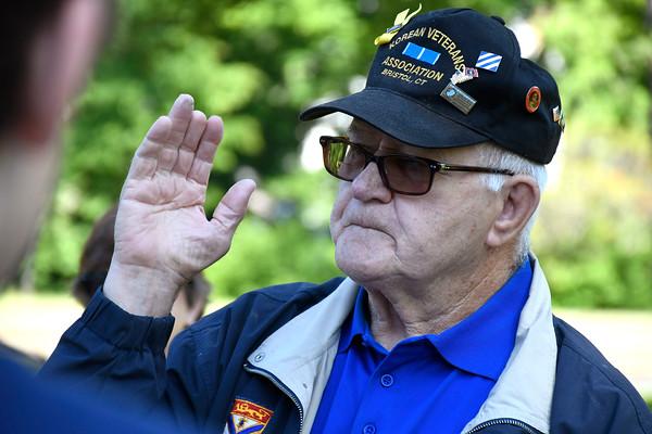 5/24/2018 Mike Orazzi | Staff Korean War veteran Bob Barnett explains the the WWII monument to Bristol high school students Thursday morning on Memorial Blvd.