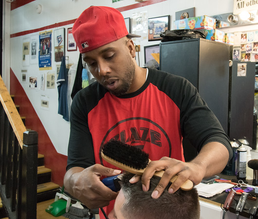 05/24/18 Wesley Bunnell | Staff Jimmy &quote;Sauce&quote; Spencer works on a client at Blaze Barbershop on West Main St in New Britain on Thursday afternoon. The barbershop is a place of discussion everyday including topics as the NFL's recent decision to require on field personnel to stand for the National Anthem.