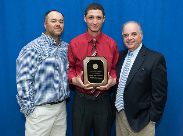 05/24/18 Wesley Bunnell | Staff New Britain High School held their Senior Scholarship Night at the high school on Thursday night. William Homar received the NBHS Baseball Award from Roberto Mercado, L, and the Ron Jakubowski Scholarship from Ron Jakubowski, R. Homar will attend SCSU.