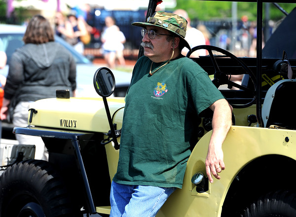 5/26/2018 Mike Orazzi | Staff Eric Weiss with his 1952 Jeep Willys during the Berlin Memorial Day activities on Saturday.
