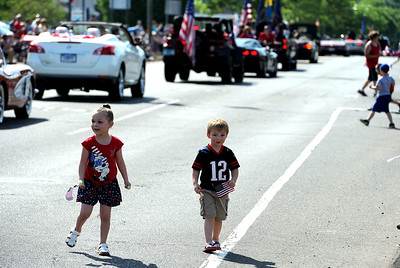 5/26/2018 Mike Orazzi | Staff Kailyn and Michael Larson collect candy during the Berlin Memorial Day Parade on Saturday along Farmington Avenue.