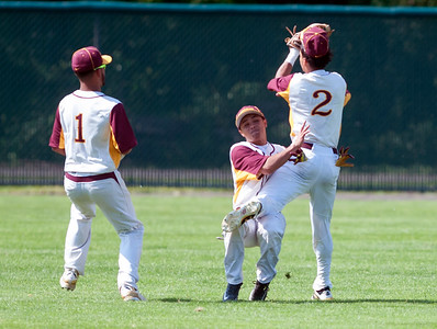 05/30/18  Wesley Bunnell | Staff  New Britain baseball defeated Enfield 4-3 with a walk off bases loaded single in the bottom of the 7th in a first round CIAC Class LL tournament game. Danniel Rivera (1) watches as Francisco Alvarado (4) collides with Justin Adorno (2) on a pop up to shallow center field.