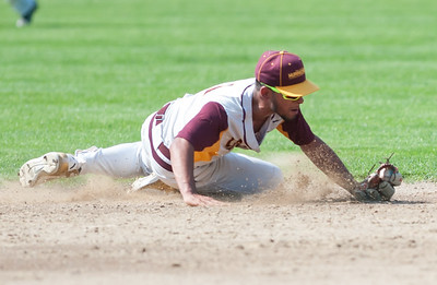 05/30/18  Wesley Bunnell | Staff  New Britain baseball defeated Enfield 4-3 with a walk off bases loaded single in the bottom of the 7th in a first round CIAC Class LL tournament game. Danniel Rivera (1) tracks down a hard hit ball glove side and throws to first for the out.