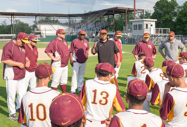 05/30/18 Wesley Bunnell | Staff New Britain baseball defeated Enfield 4-3 with a walk off bases loaded single in the bottom of the 7th in a first round CIAC Class LL tournament game. Head coach Roberto Mercado , center, surrounded by assistant coaches gives a post game talk.