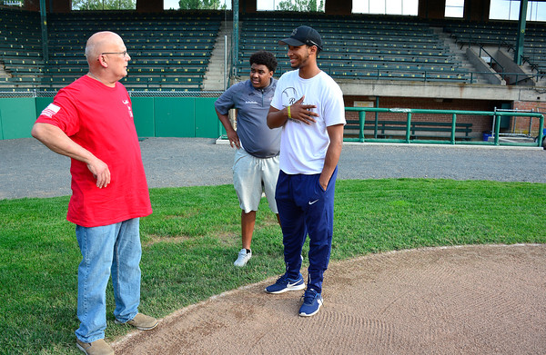 5/29/2018 Mike Orazzi | Staff Dave Blandino talks with brothers Gary and Bristol Blues player Miguel Delosantos at Muzzy Field in Bristol Tuesday evening.