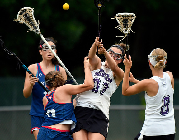 5/31/2018 Mike Orazzi | Staff 5/31/2018 Mike Orazzi | Staff St. Paul Catholic High School's Catherine Ciampi (2) and North Branford High School's Jessie Kilburn (33) during the girls Class S Quarterfinals lacrosse at North Branford High School Thursday evening.