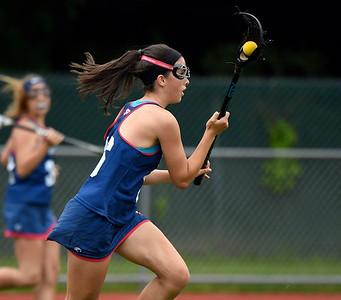 5/31/2018 Mike Orazzi | Staff St. Paul Catholic High School's  Greta Panke (16) during the girls Class S Quarterfinals lacrosse at North Branford High School Thursday evening.
