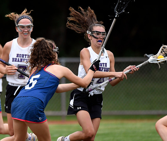 5/31/2018 Mike Orazzi | Staff St. Paul Catholic High School's Carolyn Del Debbio (5) and North Branford High School's JAli Barrett (14) during the girls Class S Quarterfinals lacrosse at North Branford High School Thursday evening.