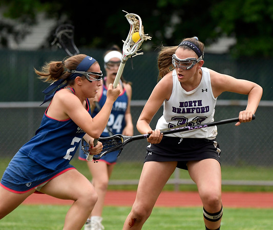 5/31/2018 Mike Orazzi | Staff St. Paul Catholic High School's Catherine Ciampi (2) and North Branford High School's Jessie Kilburn (33) during the girls Class S Quarterfinals lacrosse at North Branford High School Thursday evening.